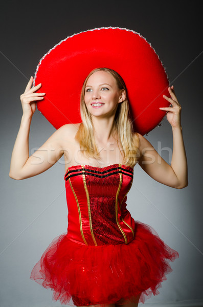 Stock photo: Woman wearing sombrero hat in funny concept