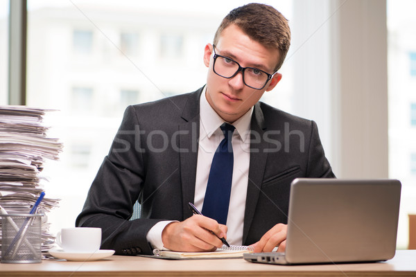 Young businessman working in the office Stock photo © Elnur