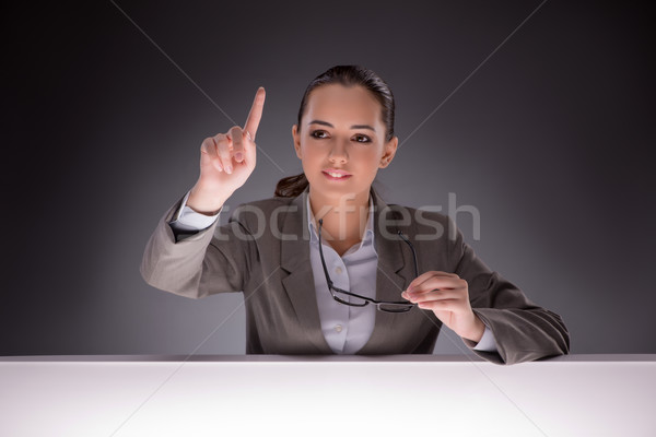 Young businesswoman working on the table Stock photo © Elnur