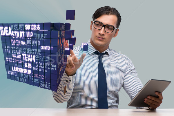 Businessman with tablet computer pressing buttons Stock photo © Elnur