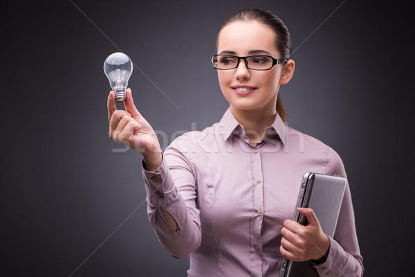 üzletasszony tart villanykörte kreativitás üzlet kéz Stock fotó © Elnur
