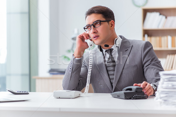 The call center operator talking on the phone Stock photo © Elnur