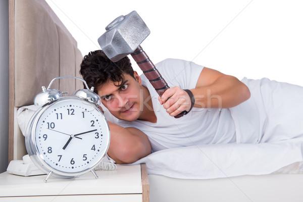 Homem cama sofrimento insônia relógio saúde Foto stock © Elnur