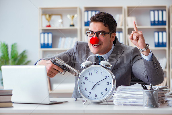 Clown businessman working in the office angry frustrated with a  Stock photo © Elnur