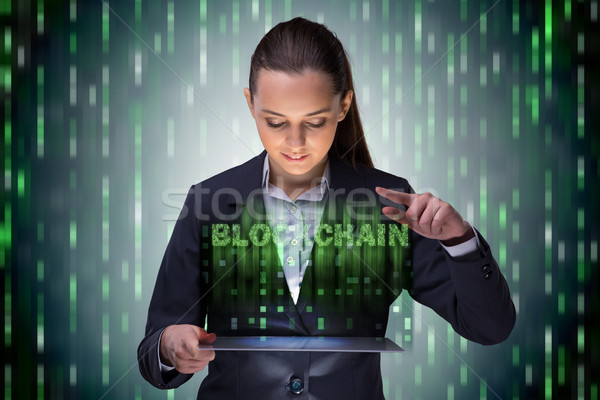 Businesswoman in blockchain cryptocurrency concept Stock photo © Elnur