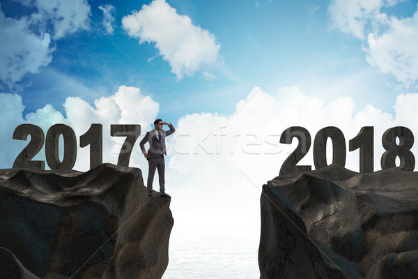 Businessman looking forward to 2018 from 2017 Stock photo © Elnur