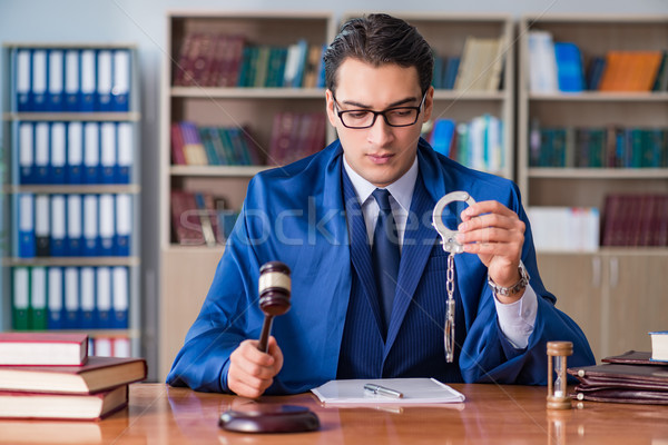 Handsome judge with gavel sitting in courtroom Stock photo © Elnur