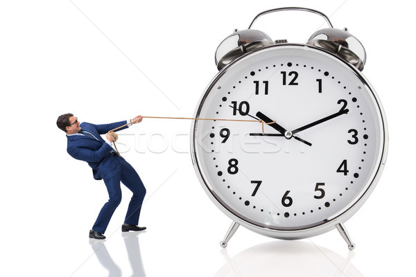 Businessman pulling clock in time concept Stock photo © Elnur
