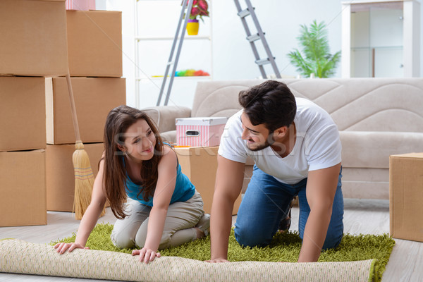 Young family unpacking at new house with boxes Stock photo © Elnur