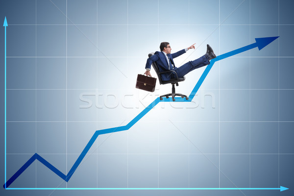 Businessman in economic growth concept Stock photo © Elnur
