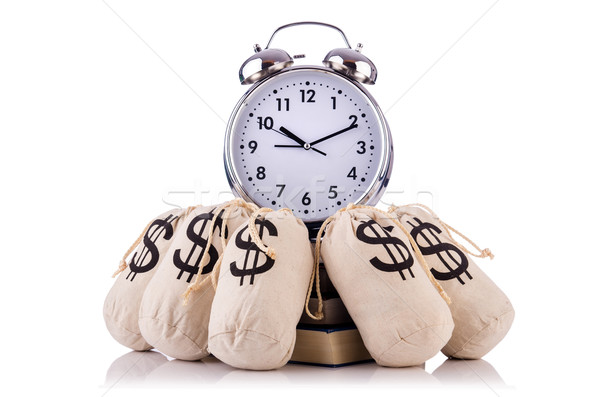 Sacks of money and alarm clock on white Stock photo © Elnur