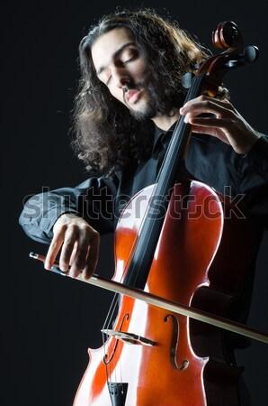 монстр играет скрипки темно комнату женщину Сток-фото © Elnur