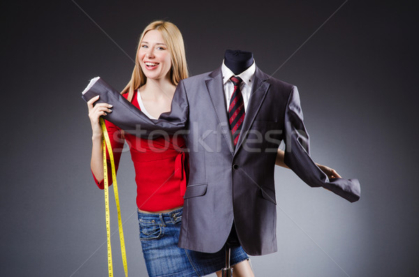 Woman tailor working on clothing Stock photo © Elnur