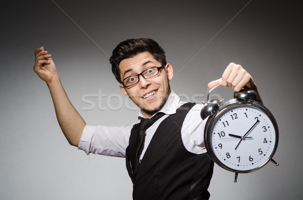 Businessman with clock in time concept Stock photo © Elnur