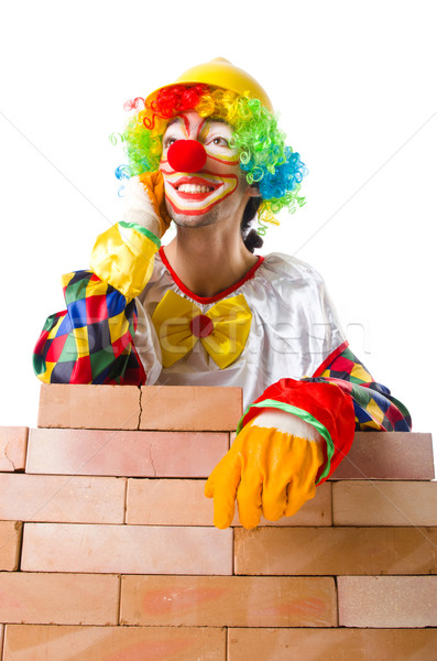 Bad construction concept with clown laying bricks Stock photo © Elnur