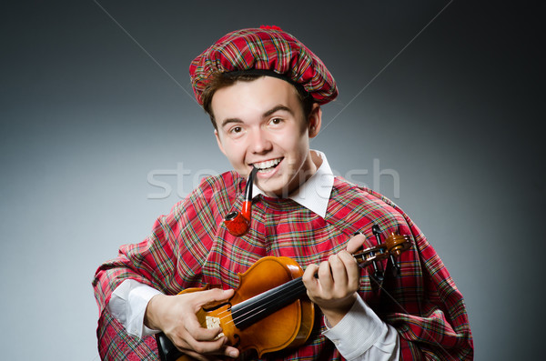 Funny scotsman with violin fiddle Stock photo © Elnur