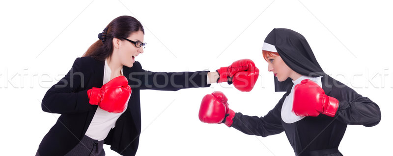 Businessman and nun boxing isolated on white Stock photo © Elnur