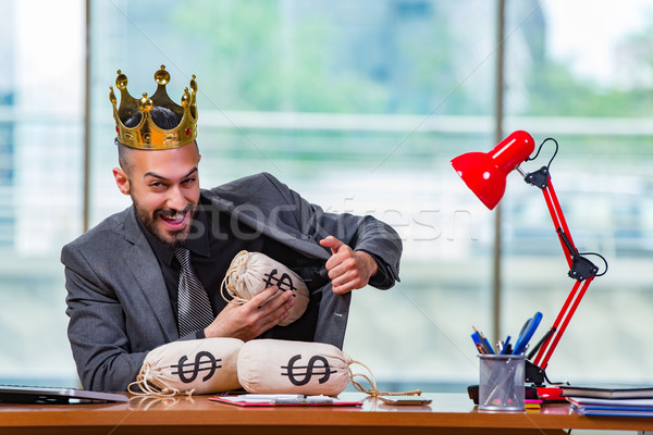 Businessman with crown and money sacks in the office Stock photo © Elnur