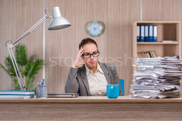 Businesswoman working in the office Stock photo © Elnur