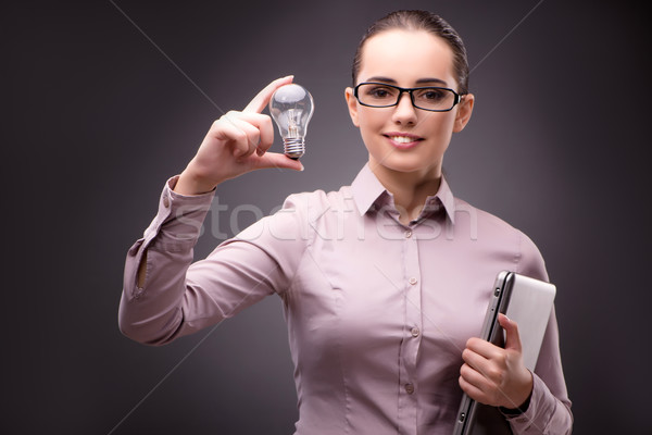 The businesswoman with lightbulb in business concept Stock photo © Elnur
