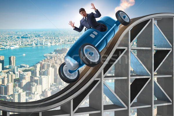The businessman driving sports car on roller coaster Stock photo © Elnur