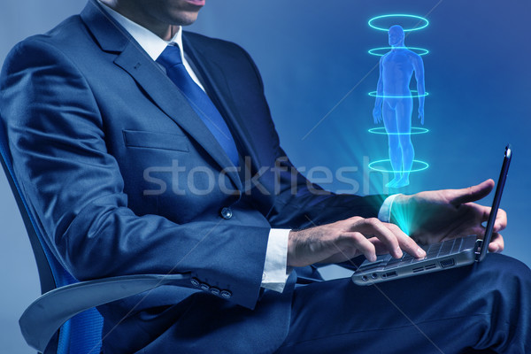 The futuristic remote diagnostics concept with businessman Stock photo © Elnur