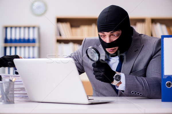 Criminal businessman with balaclava in office Stock photo © Elnur