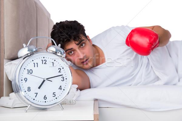 Homme lit souffrance insomnie horloge nuit Photo stock © Elnur