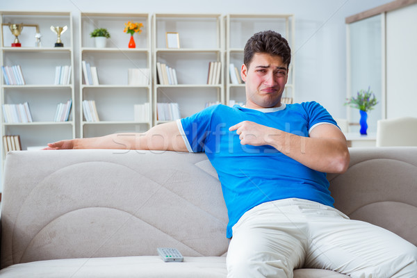 Man sweating excessively smelling bad at home Stock photo © Elnur