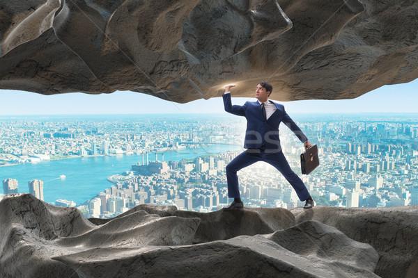Businessman supporting stone under pressure Stock photo © Elnur