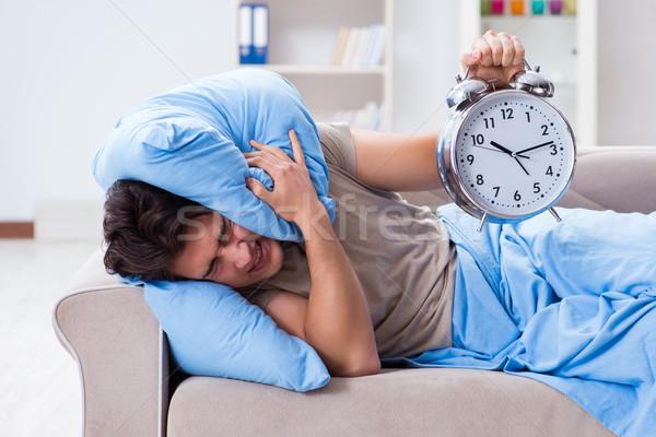 Férfi gond felfelé ébresztőóra egészség kanapé Stock fotó © Elnur