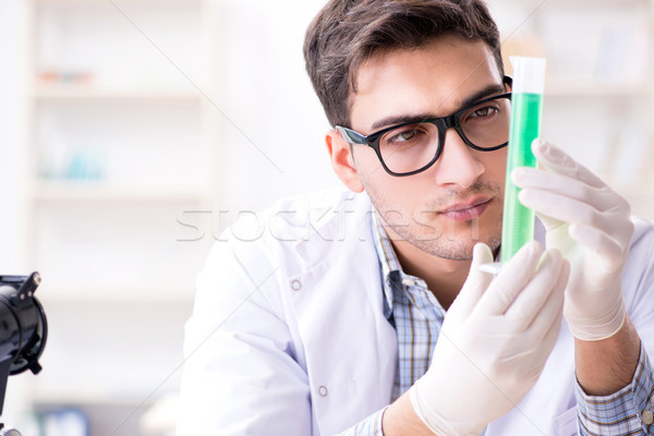 Chemistry student doing chemical experiments at classroom activi Stock photo © Elnur