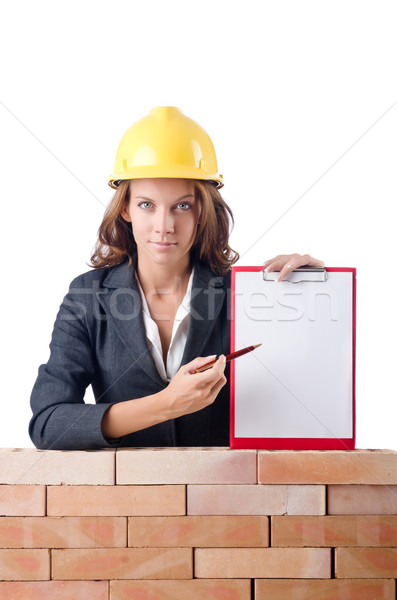Femme notepad mur de briques affaires papier construction Photo stock © Elnur