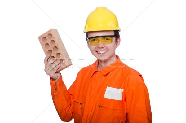 Man with brick isolated on white Stock photo © Elnur