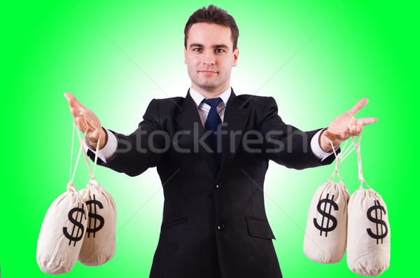 Man with money sacks on white Stock photo © Elnur