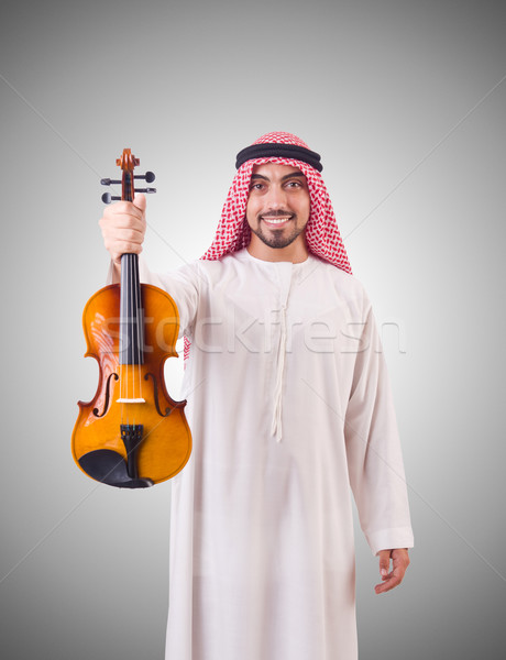 Arab man playing music on white Stock photo © Elnur