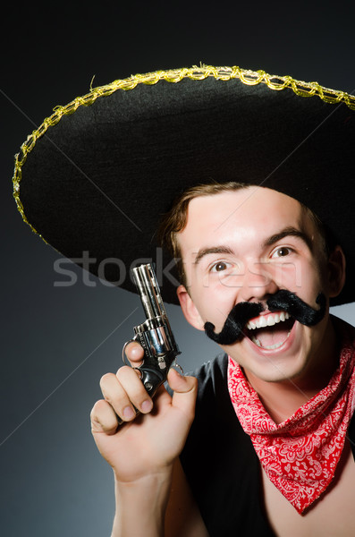 Smiling mexican with sombrero isolated on white Stock photo © Elnur