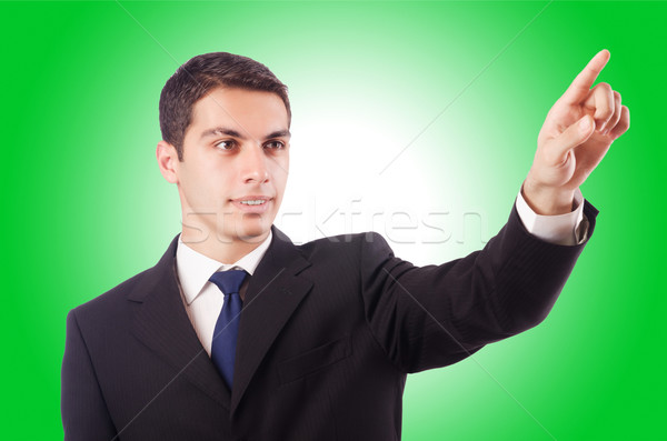 Young businessman pressing virtual buttons Stock photo © Elnur