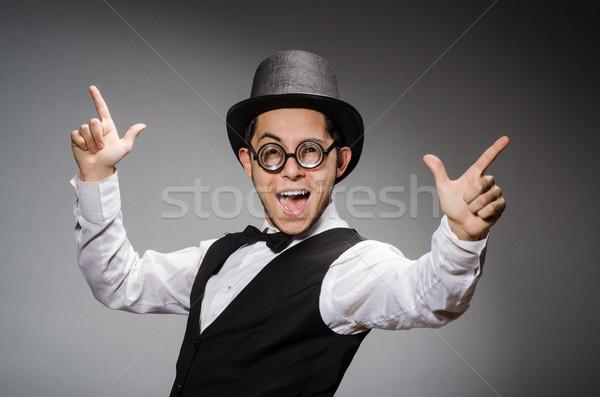 Młody człowiek klasyczny czarny kamizelka hat szary Zdjęcia stock © Elnur