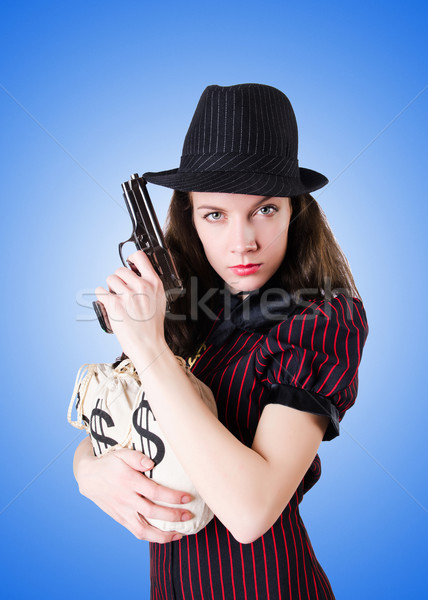 Woman gangster with handgun against the gradient Stock photo © Elnur