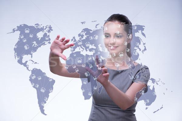 Fiatal globális üzlet üzlet iroda kéz földgömb Stock fotó © Elnur