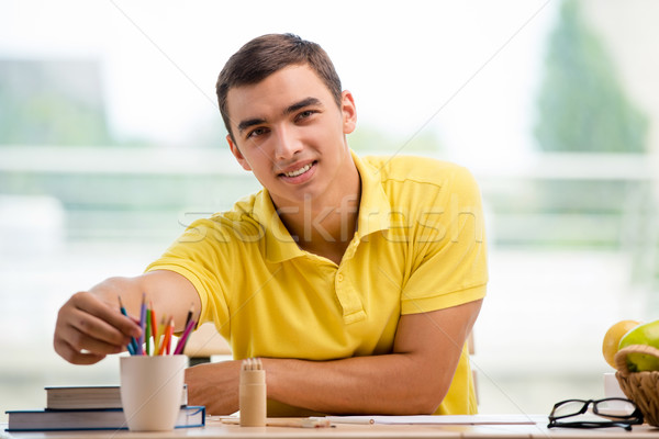 The young man drawing pictures in studio Stock photo © Elnur