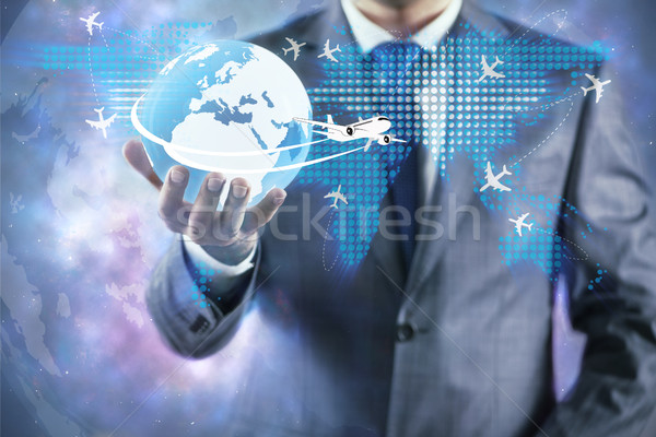Businessman in air travel concept Stock photo © Elnur