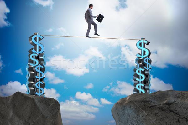 Empresário caminhada apertado corda dinheiro homem Foto stock © Elnur