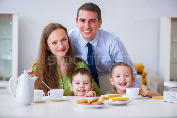 Stock photo: Happy family having breakfast together at home