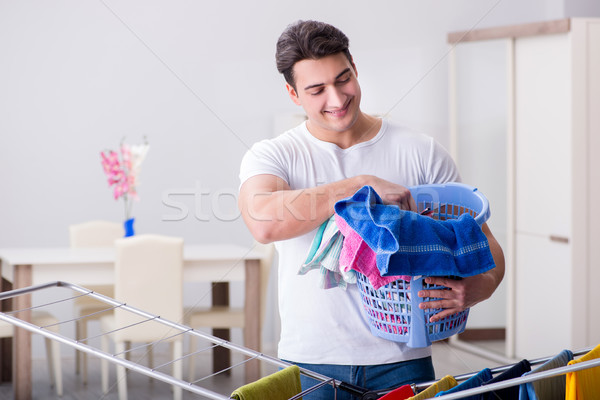 Man doing laundry at home Stock photo © Elnur