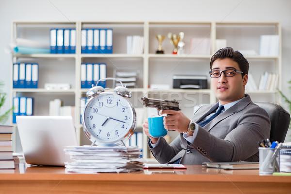 Fiatal üzletember időbeosztás munka fegyver notebook Stock fotó © Elnur