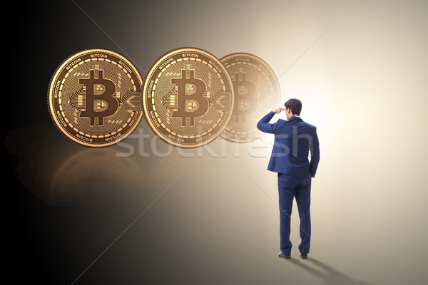 Businessman walking towards bitcoins in cryptocurrency blockchai Stock photo © Elnur