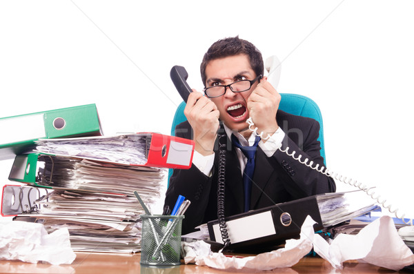 Young busy businessman at his desk Stock photo © Elnur