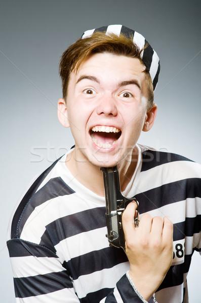 Stock photo: Funny prison inmate in concept